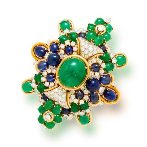An emerald, sapphire, and diamond pendant/brooch