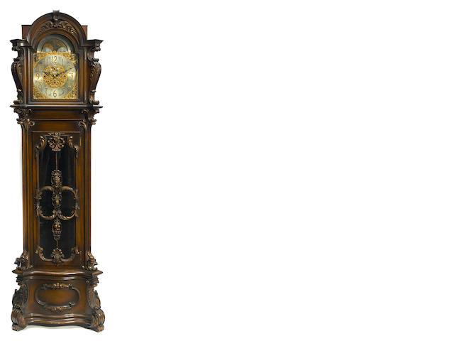 A Rococo style carved mahogany quarter chiming tallcase clock