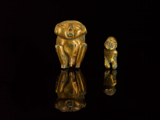 Two small gold figures