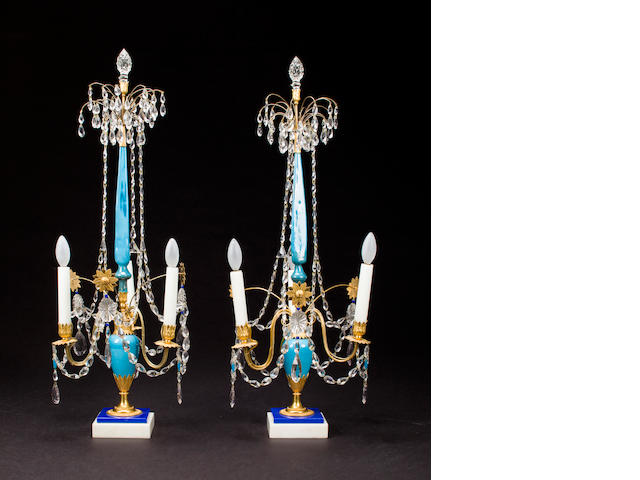 A pair of Russian Neoclassical gilt bronze mounted colored and clear glass and white marble three-light girandoles<BR />possibly Imperial Glassworks, St. Petersburg<BR />circa 1800