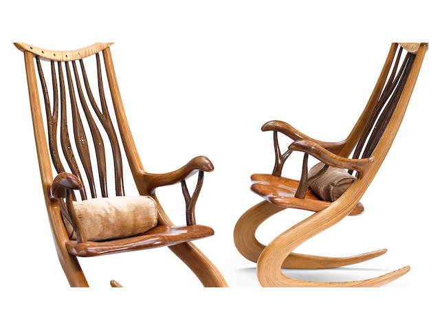 A pair of contemporary bentwood rocking chairs.