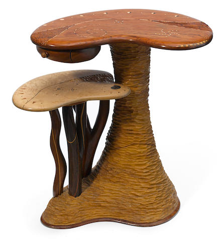A contemporary mixed-wood biomorphic occasional table.