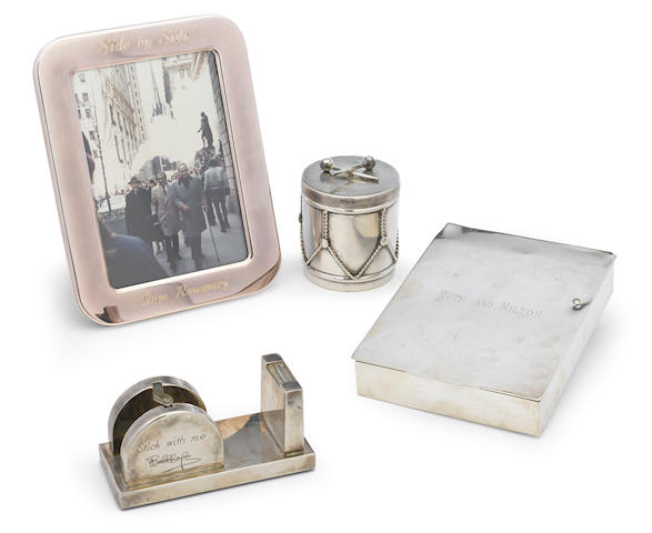 A group of two silver picture frames, tape dispenser, box ( all gifts) plus frame from Dorothy.