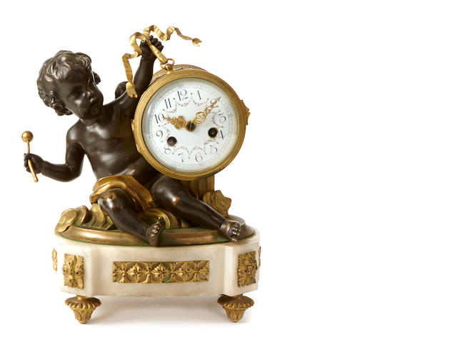A Louis XVI style gilt bronze mounted marble clock