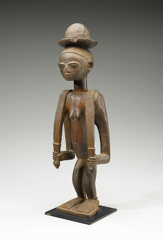 Yoruba Standing Figure, Benin/Nigeria height 24 1/4in (61.6cm)