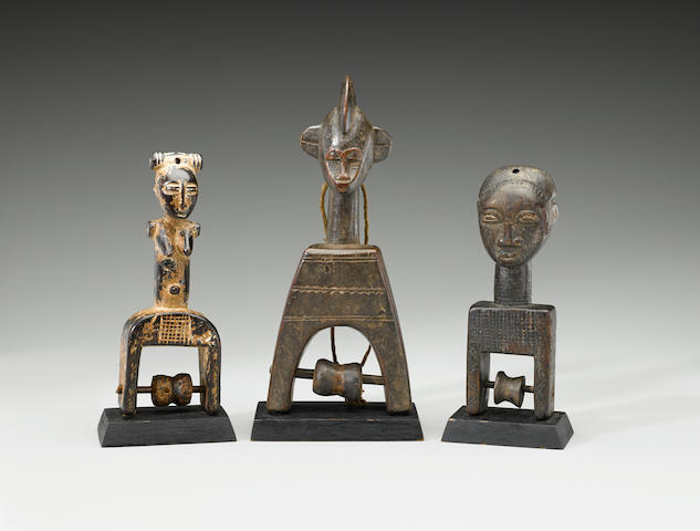 Group of Three Heddle Pulleys, Ivory Coast, inlcuding a Senufo, Attye and Baule heights 6 3/4in (17.5cm), 7 1/8in (18.2cm) and 9 1/8in (23.25cm)