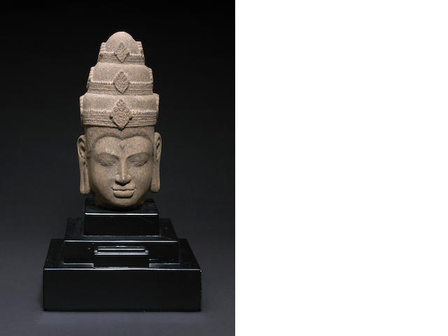 A red sandstone head of Vishnu Angkor Thom style