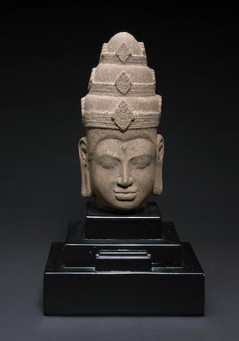 A red sandstone head of Vishnu Angkor Thom style
