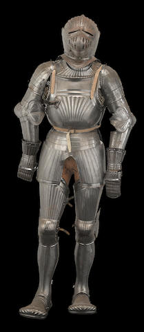 A full suit of armor in the Maximilian style