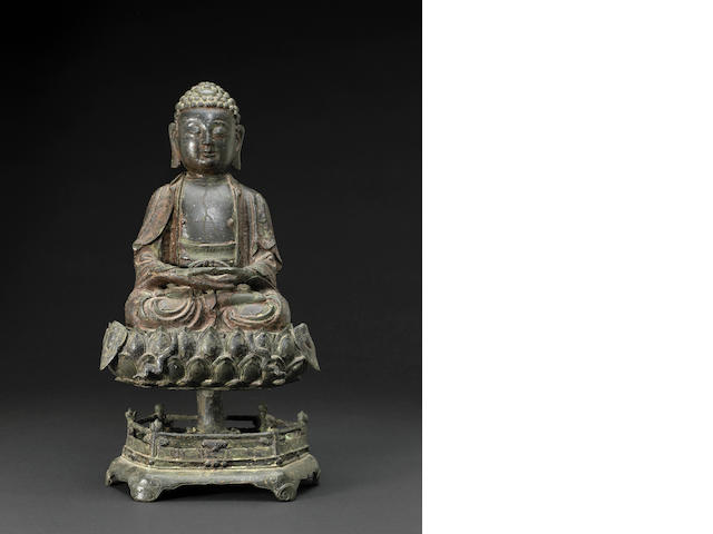 A lacquered bronze model of Buddha on a lotus petal double base