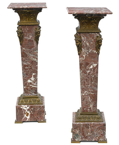 A pair of French gilt bronze mounted marble pedestals  early 20th century