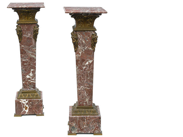 A pair of French gilt bronze mounted marble pedestals of square form