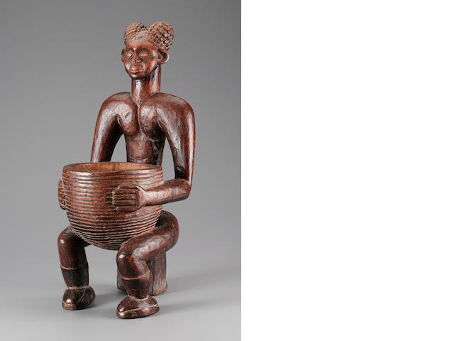 Important Grasslands Seated Male Ancestor Figure with Bowl, Cameroon height 26in (66cm)