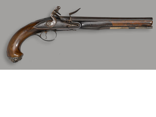 A silver-mounted English flintlock pistol by Wilson