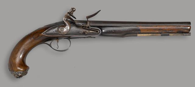 A silver-mounted English flintlock pistol by Wilson