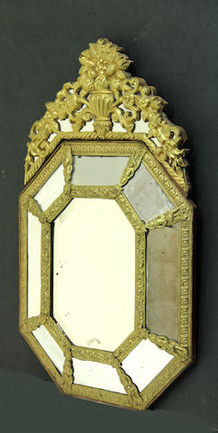 A Dutch Baroque style brass repoussé octagonal paneled mirror late 19th/early 20th century