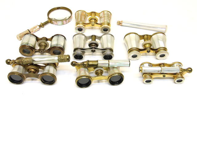 Seven French brass and mother-of-pearl opera glasses, a handle and a magnifying glass