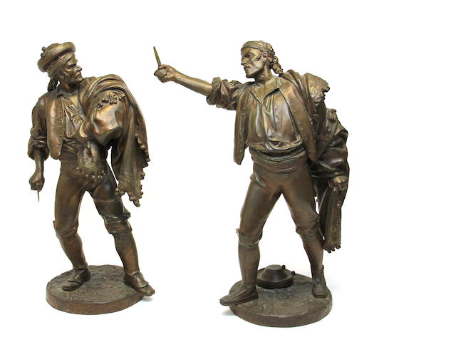 A pair of patinated white metal figures of knife fighters late 19th/early 20th century