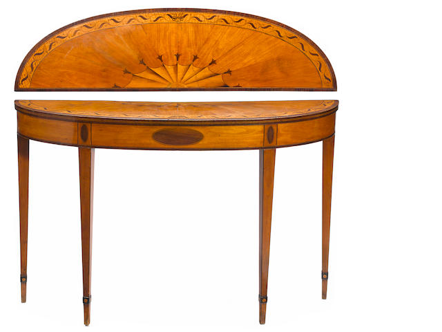 A George III mahogany and satinwood inlaid console table <BR />18th century