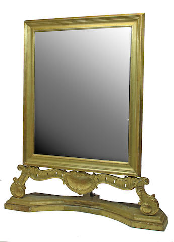 A Rococo style giltwood table mirror composed of antique elements