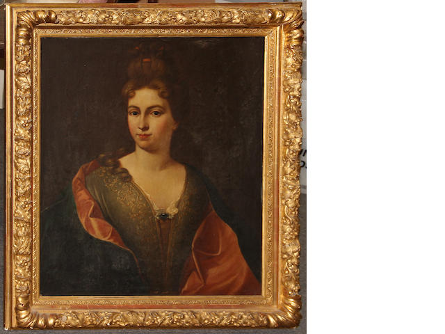 A Neoclassical carved giltwood frame enclosing a later portrait of a lady and a gilt gesso molded frame enclosing an engraving of Marguerite de Valoi, Reine de Navarre