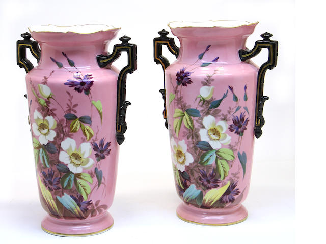 A pair of floral painted porcelain vases