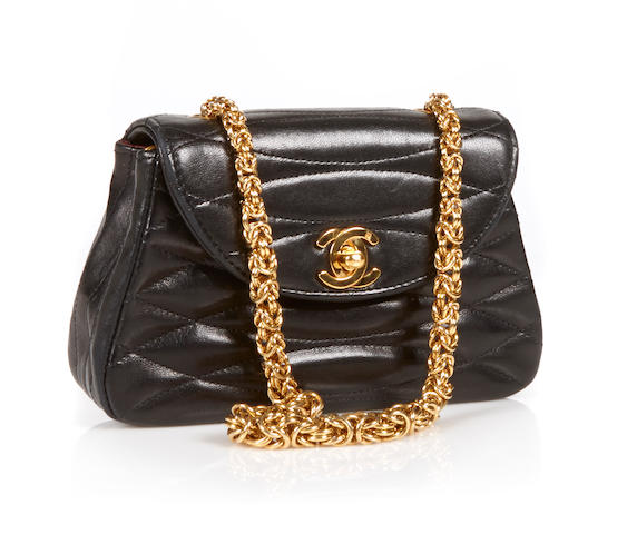 A Chanel small black quilted leather handbag