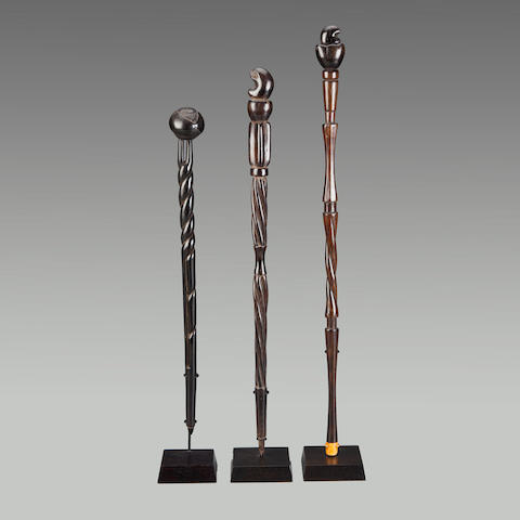 Two Makonde Staffs and a Sanu Staff, Tanzania heights 16 - 20 3/4in (40.6 - 52.7cm)