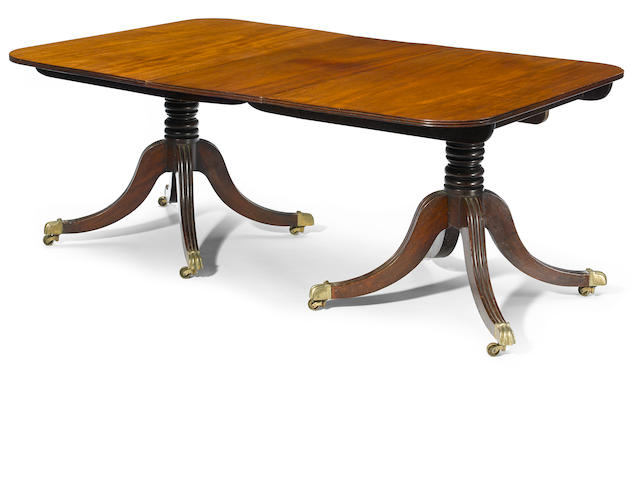 A George III mahogany double pedestal dining table <BR />early 19th century