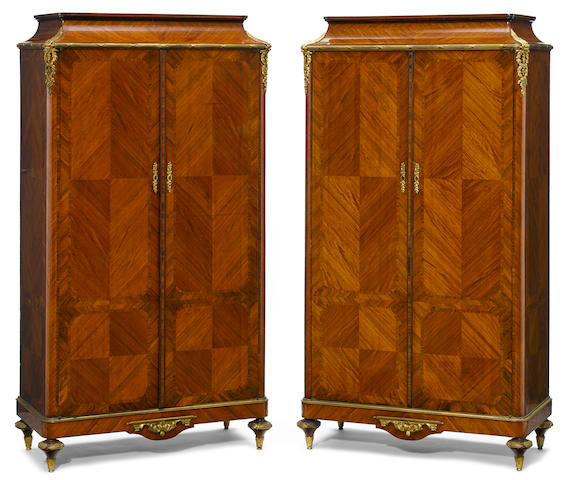 A pair of French gilt bronze mounted inlaid walnut meuble d'appui  possibly Paul Sormani  late 19th century
