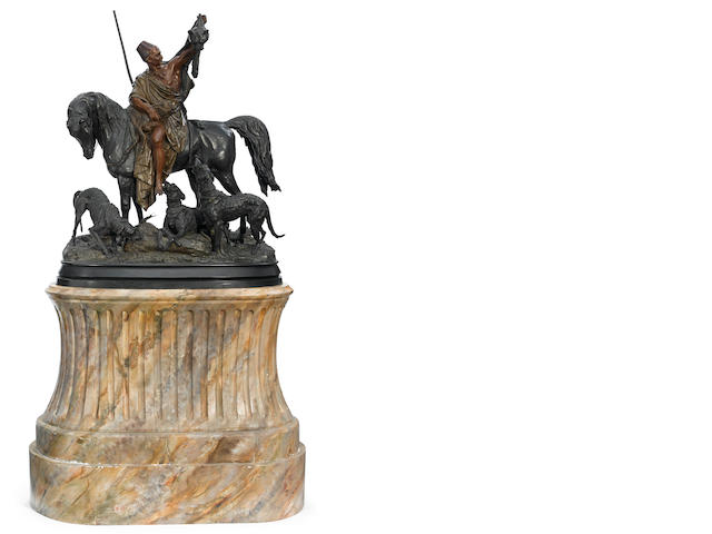 An imposing bronze equestrian group after Wagen on faux marble base