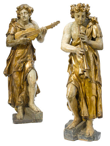 Two Italian Baroque parcel gilt and paint decorated figures of musicians