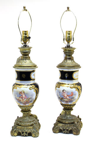 A pair of Sèvres style porcelain and gilt bronze table lamps last quarter 19th/first quarter 20th century