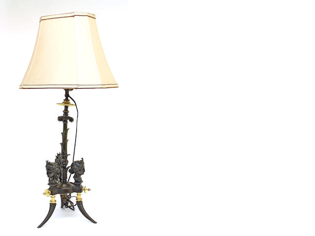 A French Aesthetic patinated and gilt bronze standard, now as table lamp fourth quarter 19th century