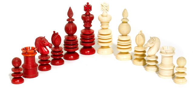 An English natural and stained ivory chess set <BR />possibly by Calvert<BR />second half 19th century