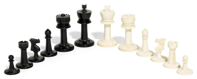 An Anglo Indian natural and stained ivory chess set <BR />early 20th century