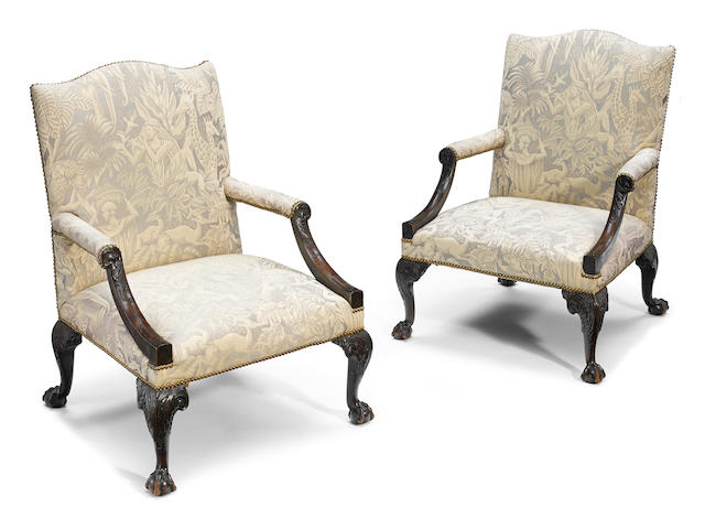 A good pair of George III carved mahogany upholstered library armchairs <BR />possibly Irish <BR />second half 18th century
