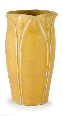 A Grueby Faience Company mustard yellow glazed earthenware vase circa 1900