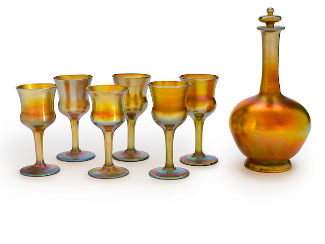A Tiffany Studios gold Favrile glass decanter set circa 1905