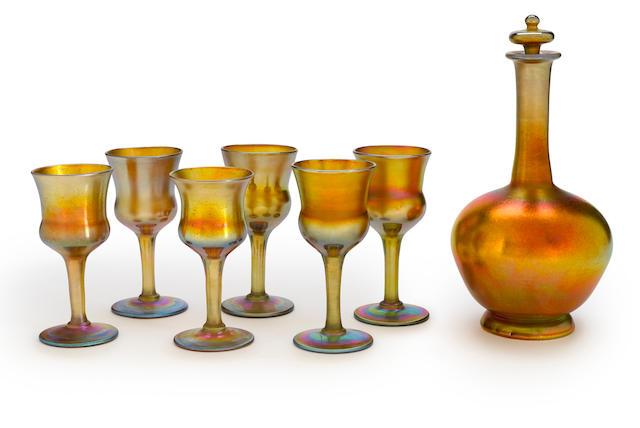 A Tiffany Studios gold Favrile glass decanter set circa 1905