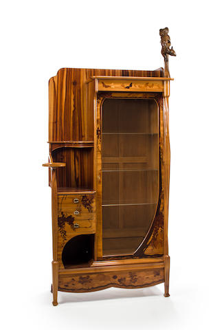 An unusual Majorelle carved and fruitwood-marquetry inlaid mahogany cabinet circa 1900