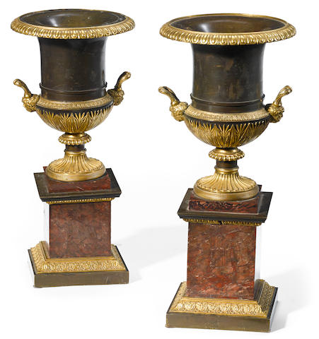A pair of Empire style gilt and patinated bronze and marble urns  19th century