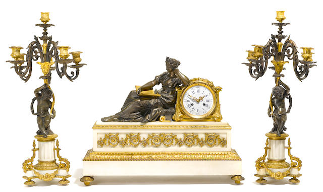 An assembled Louis XVI style gilt, patinated bronze and marble clock garniture  late 19th/early 20th century