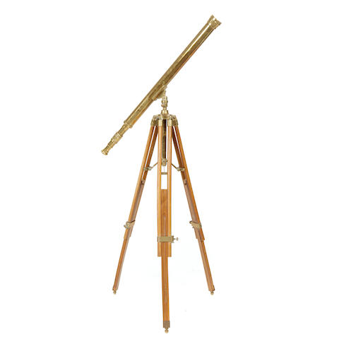 A brass telescope with tripod stand