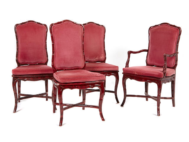 A set of ten custom Paul Laszlo red lacquered wood dining chairs circa 1977