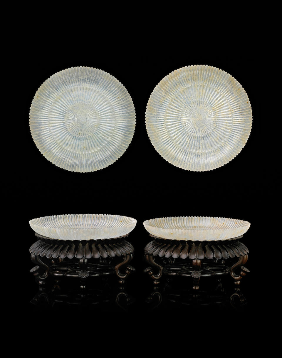 A fine pair of jadeite 'chrysanthemum' dishes Qianlong marks, late Qing/Republic period