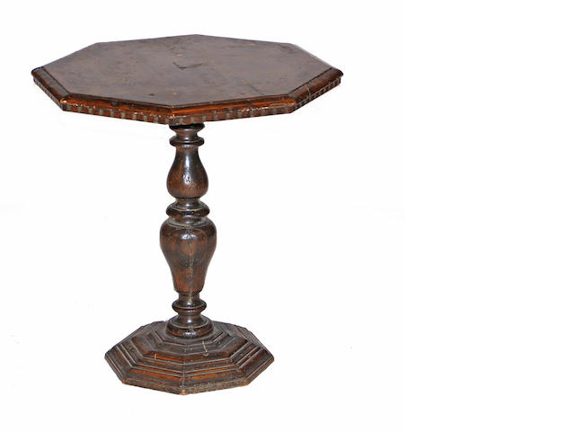 A pair of Italian Baroque walnut pedestal tables