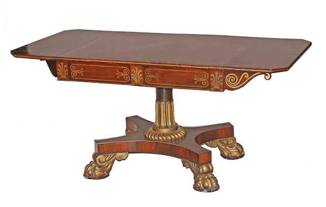 A Regency style brass inlaid mahogany and rosewood sofa table