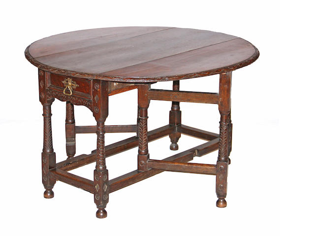 A William and Mary style oak gate leg table late 19th century