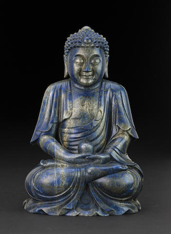 A carved lapis lazuli figure of the Buddha